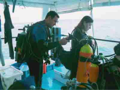Neil Harris assists a student with her gear prior to a dive at Flinders Reef.